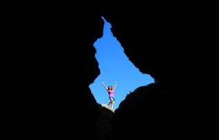 Me outside a cave