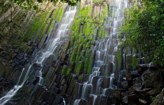 "Paul Caddy (@PaulSCaddy) of the UK ""splurged"" on a police escort when he went to this lovely waterfall in El Salvador. It cost him a few dollars: pic.twitter.com/E63Iix3hdO"