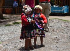 @Globe_Guide shared this sweet photo of little girls in Peru. Whether that's a baby sheep or dog she's holding, it's pretty adorable: pic.twitter.com/Wdz5VUprc4