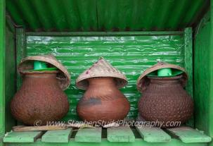 Stephen Studd (@StephensPhotos) of the UK caught a not-so-subtle green in a subtle place: small green water vessel shacks in Myanmar: https://twitter.com/StephensPhotos/status/511596367060668416/photo/1