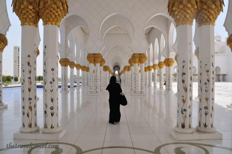 Shane Dallas (@TheTravelCamel) of the UAE caught the perfect contrast of a stranger walking in an Abu Dhabi mosque: https://twitter.com/TheTravelCamel/status/524282669928964096/photo/1