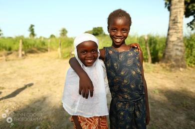 Two friends in a village needing water