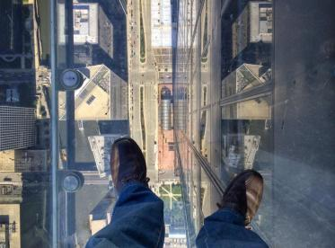 Joseph (@Allophile) of the USA took this downward-facing shot in, of course, the Willis Tower of Chicago: https://twitter.com/Allophile/status/531902342258786304/photo/1